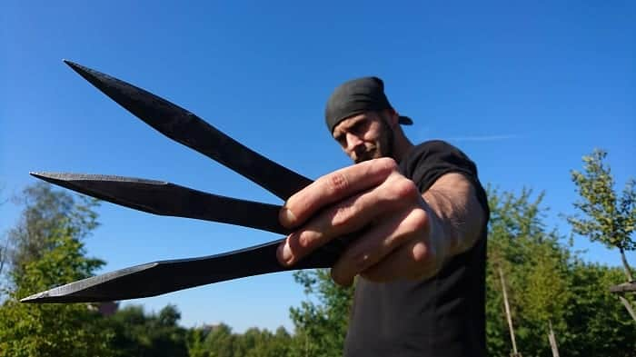 Man Holding Throwing Knives