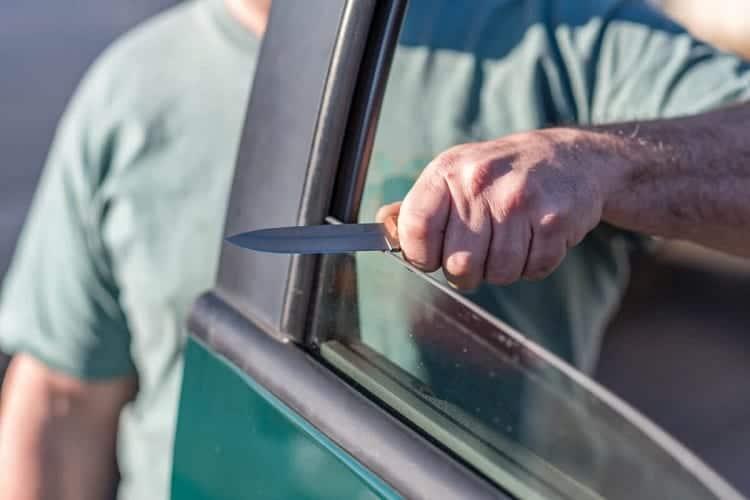 Sharpening Knife On Car Window