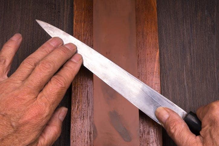 Sharpening knives on whetstone